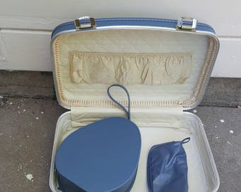 1970s triple suitcase -- a cosmetic case that fits inside a carry-on suitcase that fits inside a weekender -- all in retro French blue