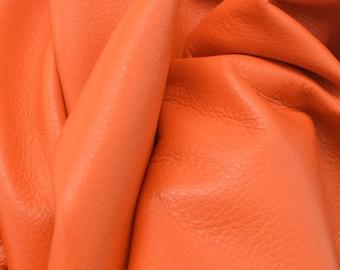 "Leather Cow hide side 25.1 Sq Ft Classic Orange Crush ""Signature""  2-2 1/2 oz flat grain DE-56491 (Sec. 9,Shelf 2,A)"