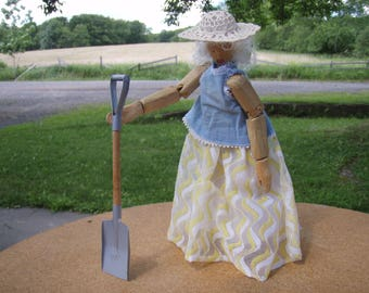 Homemade wooden gardener doll