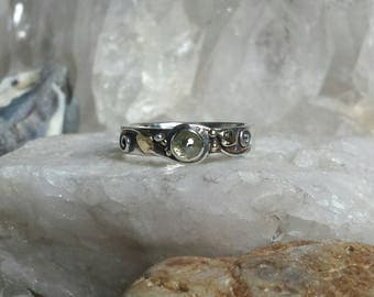 Diamond set Sterling Silver Ring with touches of Gold.