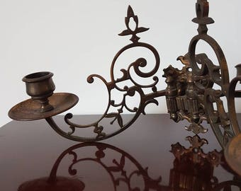 A pair of late Victorian brass double candle sconces