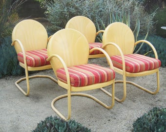 Set of 4 vintage metal clam shell patio chairs