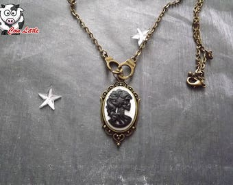 Bronze cameo necklace black and white skeleton woman with handcuffs