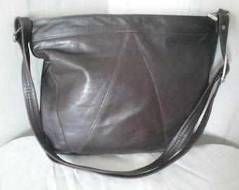 Dark brown soft leather bag with adjustable shoulder strap