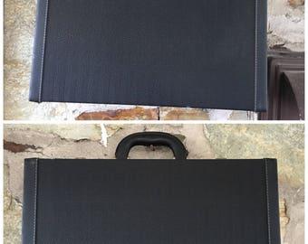 Samsonite Creation Frenze black herringbone embossed briefcase with gold hardware with internal pockets.