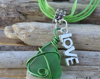 Green frosted glass and charm pendant necklace Love by JosieCoccinelle