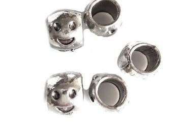 Pack of 30 smiley beads on silver cord