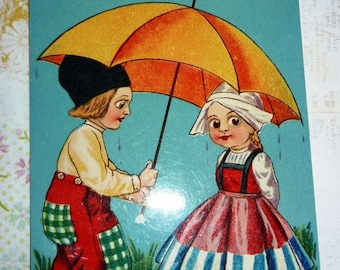 ON SALE till 7/28 Unused Antique Dutch Boy and Girl With Umbrella