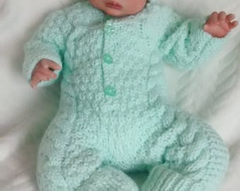 "Hand knitted all in one set to fit a 17/18"" reborn doll"