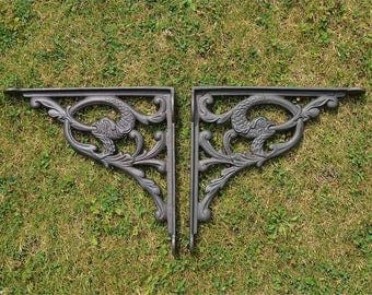 A pair of large antique mythical serpent wall shelf brackets solid cast iron 10 inch AL82