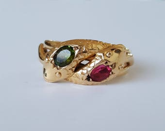 1913 Entwined snake ring with two tourmalines in 18ct gold