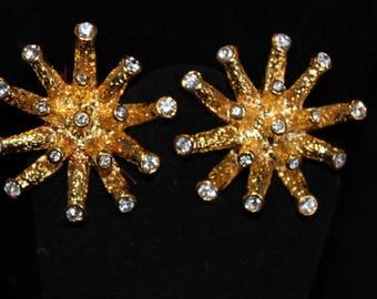 Goldtone starburst clip earrings with rhinestones