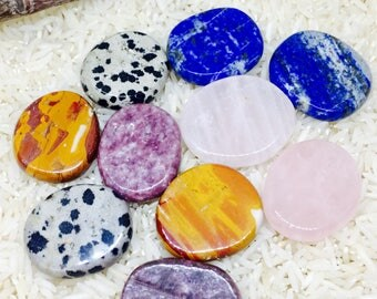 lapis lazuli , rosequartz , Dalmatian  jasper, mookite, lepidolite crystal palm stones.crystals. All stones are natural and polished