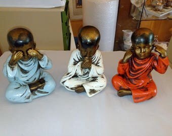 Three Buddha children nothing see anything hear anything smelling about twenty inches high