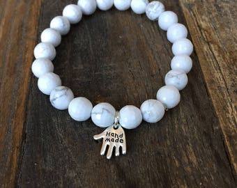 Bracelet.  SILVER 'Hand Made' Charm made from Natural, Genuine AA Grade HOWLITE Faceted  8mm round gesmtones / beads. Stretch