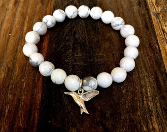 Bracelet. Sterling SILVER 925 Bird Charm made from Natural, Genuine AA Grade HOWLITE Faceted  8mm round gesmtones / beads. Stretch