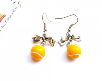 Earrings sport lovely tennis balls