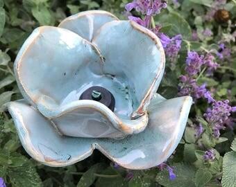 Turquoise ceramic poppy