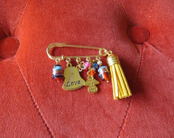 Gold pin and its beautiful charms.