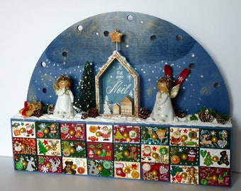 ADVENT calendar in antique blue wood, with 24 drawers and a decorated bow