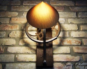 Unique lamp for your wall made of iron parts of an old sewing machine plus reclaimed wood