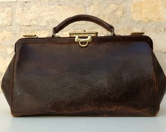 Antique French small leather doctor's bag with brass locks, Gladstone bag circa early 1900s.