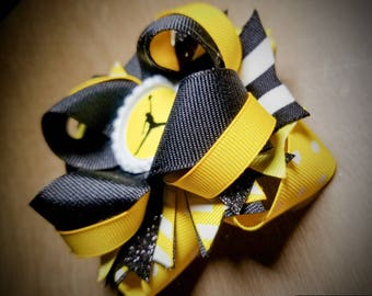 Yellow and black 3.5 inch Jordan inspired boutique style bow w/ lined alligator clip