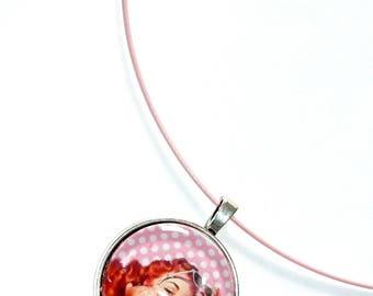 Collar pin amid pink polka dots