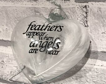 Christmas feather bauble, angels are near bauble, feathers appear bauble, remembrance bauble