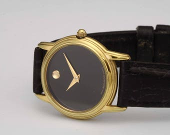 Classic Ladys Movado Museum Dial 87.E4.9840 Gold Bezel Black Dial Dress Watch