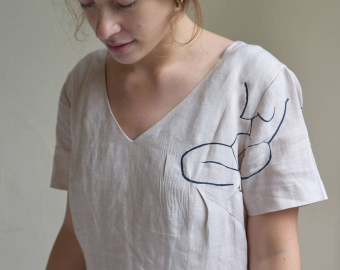 Moira Cream Linen Short Sleeve Sheath Dress.