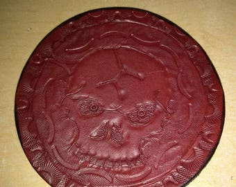red hand stamped, carved and dyed skull on leather