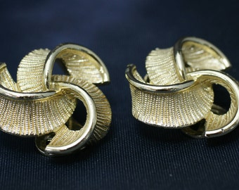 Ribbon Swirl Gold Tone Clip Earrings