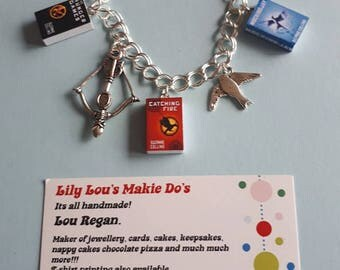 The Hunger Games based 3 mini book charm bracelet with Silver Mocking Jay and Katniss bow & Arrow
