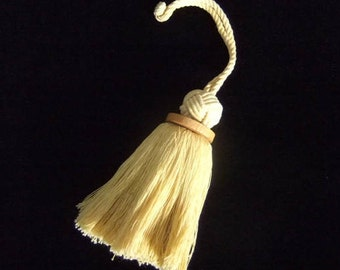Soft Yellow Cotton Knot Top and Rough-Hewn Wood Tassel