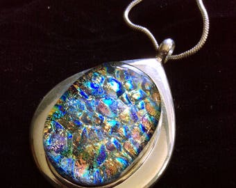 Dichroic fused glass necklace in silver setting