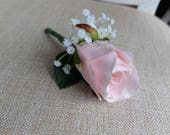Pale pink and white silk ...
