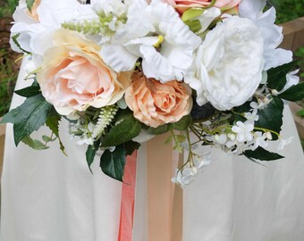 Coral, peach, white and ivory silk wedding bouquet. Made with artificial roses, hydrangea, lisianthus, jasmine and peonies.