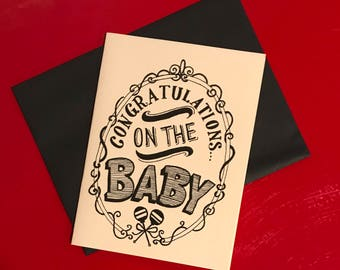 black and white hand lettered congratulations on the baby card