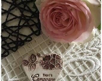 A pretty heart in white color ceramic stoneware and taupe