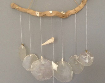 Decorative hanging mobile sound, mother-of-Pearl discs, shells and Driftwood