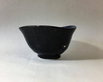 Raku matcha chawan, Japanese teabowl, with glossy black raku glaze, oxidized. Tea ceremony.
