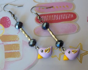 Platinum earrings with a mauve kawaii bird made with polymer clay and beads