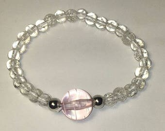 Clear sparkly stretch bracelet with silver accent beads. Stretchy One Size