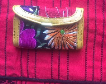 small leather wallet embroidered with colorful flowers