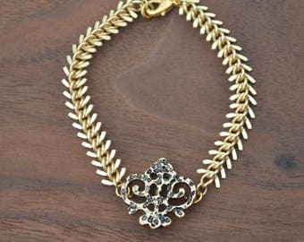 spiked gold and bronze bracelet