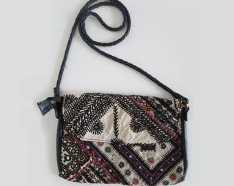 Small embroidered bag with shoulder strap