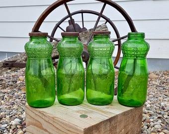 Green Glass Bottles Embossed Shoulders Set of Four Vintage Green Color