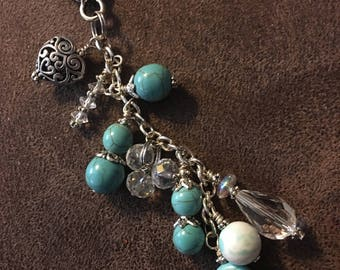 Beaded purse charm, turquoise blue beads, Multiple shapes .scroll work heart charm and crystal bead dangle, Lobster claw clasp.