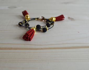 Red tassel black and gold bracelet